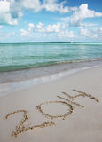 Numbers 2014 on Tropical Sand Beach. Holiday concept Royalty Free Stock Photography