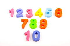 Numbers on white background. Plastic numbers on white background Royalty Free Stock Images