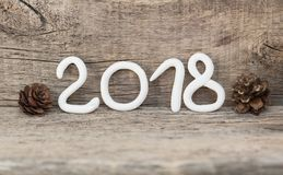 Numbers from white clay forming the number 2018, Element for a postcard new year 2018 on a rustic wooden background. Stock Images