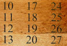 Numbers on wood surface. Abstract background with numbers on wood texture Royalty Free Stock Photos