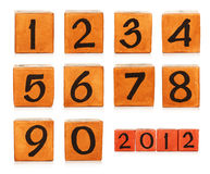 Numbers on wooden painted cubes Royalty Free Stock Images