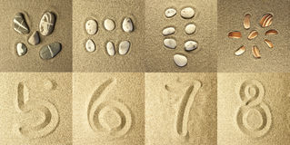 Numbers Written in the Sand and stones. Golden colors Royalty Free Stock Photography