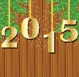Numbers 2015 year on a wooden background with the branches of ch Stock Image