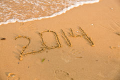 2014 numbers on the yellow sandy beach Stock Photo