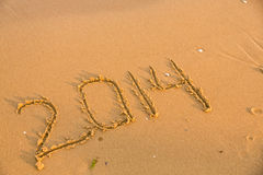 2014 numbers on the yellow sandy beach Stock Image