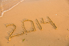 2014 numbers on the yellow sandy beach Royalty Free Stock Image