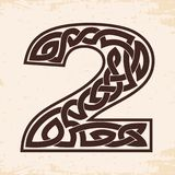 Numeral with Celtic ornament. Arabic numerals with Celtic national ornament as interlaced ribbon on a beige background. Paryrus with the aging effect Royalty Free Stock Photos