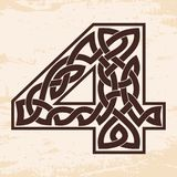 Numeral with Celtic ornament. Arabic numerals with Celtic national ornament as interlaced ribbon on a beige background. Paryrus with the aging effect Stock Photos