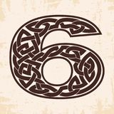 Numeral with Celtic ornament. Arabic numerals with Celtic national ornament as interlaced ribbon on a beige background. Paryrus with the aging effect Royalty Free Stock Image