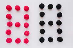 The numeral eight is written in black and red on a white backgro Royalty Free Stock Photo