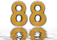 Numeral 88, eighty eight, reflected on the water surface Stock Photography