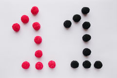 The numeral one is written in black and red on a white backgroun Royalty Free Stock Image
