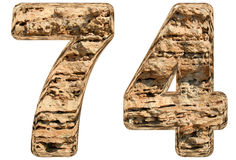 Numeral 74, seventy four,  on white, natural limestone, Royalty Free Stock Image