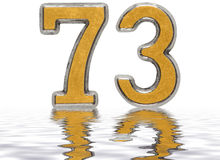 Numeral 73, seventy three, reflected on the water surface, isola Royalty Free Stock Photos