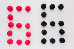 The numeral six is written in black and red on a white backgroun Stock Image