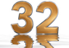 Numeral 32, thirty two, reflected on the water surface,  Royalty Free Stock Images