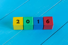 Numeral 2016 year on children's colourful cubes or. Blocks Stock Photos