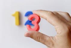 Numere ímãs do refrigerador Imagens de Stock