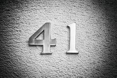 Numere cuarenta y uno en la pared de una casa Imagen de archivo