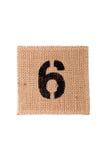Numere el saco de la arpillera aislado en un fondo blanco con el espacio vacío Foto de archivo libre de regalías
