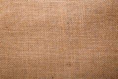 Numere el saco de la arpillera en un fondo blanco con el espacio vacío Fotografía de archivo libre de regalías