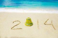 Numere 2014 en la playa arenosa - concepto del día de fiesta Fotografía de archivo
