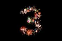 Numere las sillas de playa 3 Alfabeto del número hecho de fuegos artificiales reales Imágenes de archivo libres de regalías