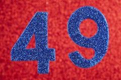 Numere quarenta e nove cores do azul sobre um fundo vermelho anniversary Fotografia de Stock
