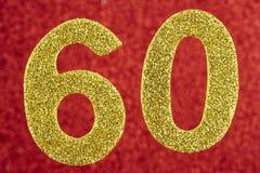 Numere sessenta cores amarelas sobre um fundo vermelho anniversary Imagens de Stock