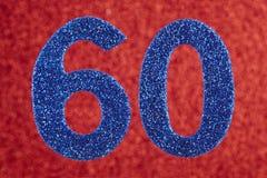 Numere sessenta cores do azul sobre um fundo vermelho anniversary Imagem de Stock