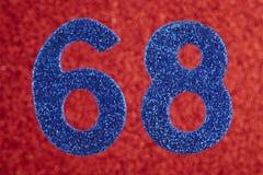 Numere sessenta e oito cores do azul sobre um fundo vermelho anniversary Foto de Stock Royalty Free