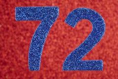 Numere seventy-two cores do azul sobre um fundo vermelho anniversary ilustração royalty free