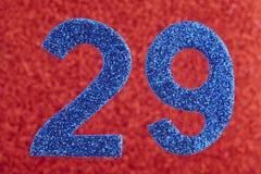 Numere vinte e nove cores do azul sobre um fundo vermelho anniversary ilustração do vetor
