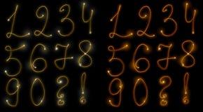 Numeri ardenti Immagine Stock