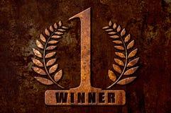 Numeri 1 concetto del vincitore sul fondo della ruggine del metallo Immagine Stock