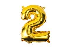 Numeri dai palloni dorati gialli su un fondo bianco Fotografia Stock