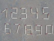 Numeri 1 2 3 4 5 6 7 8 9 0 dalla figura aritmetica di conteggio otto della partita fotografia stock libera da diritti