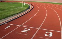 Numeri del vicolo della pista di Athlectics Fotografie Stock