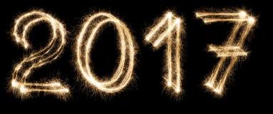 Numeri della stella filante della fonte del nuovo anno su fondo nero Immagini Stock
