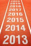 Numeri di anno sulla pista corrente di atletica Fotografia Stock Libera da Diritti