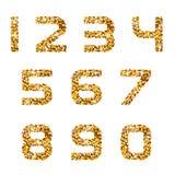 Numeri di fonte dorati delle scintille Immagine Stock