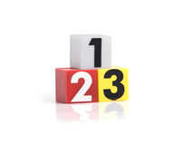 Numeri di plastica variopinti su fondo bianco Fotografia Stock