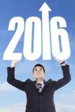 Numeri di sollevamento 2016 della persona di affari Fotografia Stock Libera da Diritti