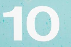 Numeri 10 dieci di vecchia del metallo struttura blu del fondo Immagini Stock Libere da Diritti