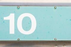 Numeri 10 dieci di vecchia del metallo struttura blu del fondo Immagine Stock Libera da Diritti