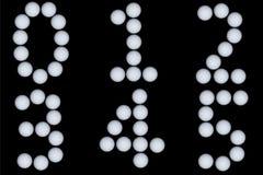 Numeri disegnati con le palle da golf Immagini Stock
