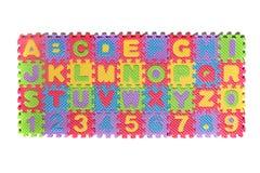Numeri e lettere di puzzle della schiuma Fotografia Stock Libera da Diritti