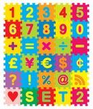 Numeri e puzzle di simboli Fotografie Stock