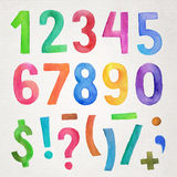 Numeri e simboli scritti a mano dell'acquerello Fotografia Stock
