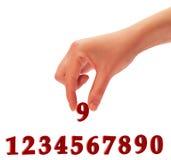 Numeri e una mano Immagini Stock